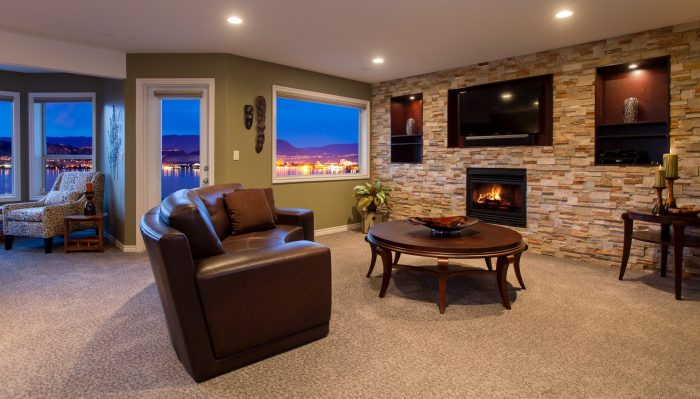 Interior Design Kelowna - Living room with stone feature wall