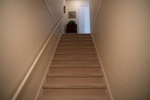 Full home renovation - Entryway stairwell before | Creative Touch Kelowna Interior Design